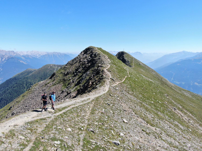 """""""Das Bild stellt für mich die Freiheit durch die unfassbaren Größen der Natur dar. Die Freiheit zeigt sich in der Dominanz der Berge und der  Weite des Ausblickes."""""""